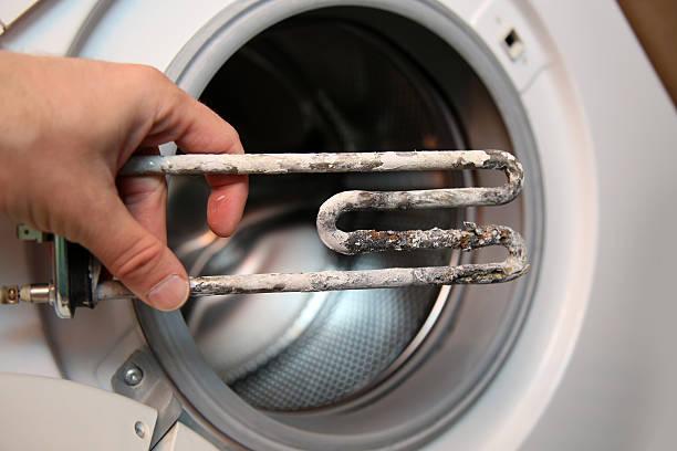 Фото почему из стиральной машины неприятный запах - налет на ТЭНе